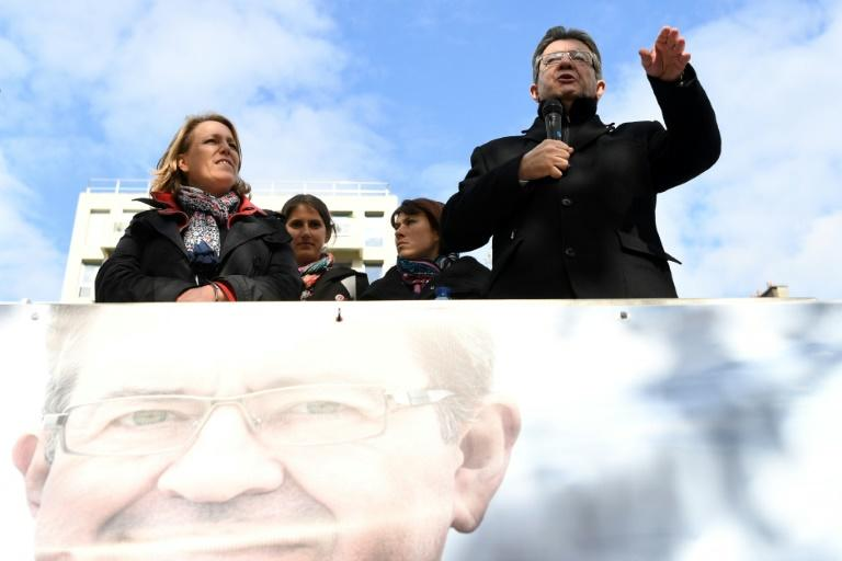 "French presidential election candidate for the far-left coalition La France insoumise Jean-Luc Melenchon, speaks next to Left Party's coordinator Dannielle Simonnet aboard an ""unbowed"" barge on the Canal Saint-Martin on April 17, 2017 in Paris"