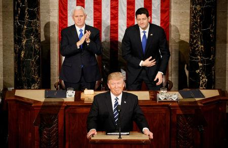 U.S. President Trump addresses Joint Session of Congress - Washington, U.S. - 28/02/17 - U.S. President Donald Trump pauses as he speaks in front of Vice President Mike Pence (L) and Speaker of the House Paul Ryan. REUTERS/Jim Bourg