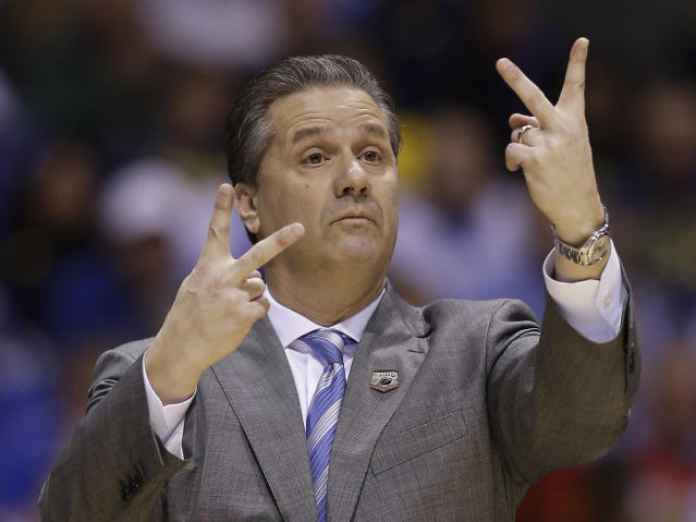Kentucky head coach John Calipari signals during the first half of an NCAA Midwest Regional semifinal college basketball tournament game against the Louisville Friday, March 28, 2014, in Indianapolis. (AP Photo/David J. Phillip)
