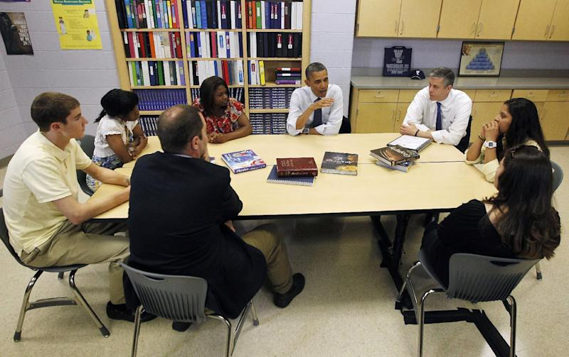 FILE - This May 4, 2012 file photo shows President Barack Obama, center, and Education Secretary Arne Duncan, right, meeting with students and their parents at Washington-Lee high school in Arlington, Va. Loose ends and thorny partisan tensions on education await the next Congress and President Barack Obama's second term. First up is the fiscal cliff, which will slash billions from the Department of Education's budget if lawmakers don't act this year. From left are, Brendan Craig, Kezia Truesdale, Amirah Delwin, Rina Castaneda, Elma Molina, and Tim Craig. (AP Photo/Pablo Martinez Monsivais, File)