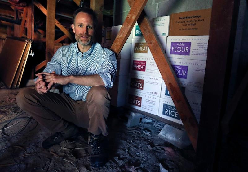 Survivalist Adam Taggart has stockpiled months worth of canned food in his home in Sebastopol, California (AFP Photo/MONICA DAVEY)
