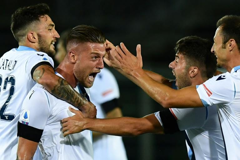 Lazio's Serbian midfielder Sergej Milinkovic-Savic (2ndL) celebrates after scoring against Atalanta in Bergamo