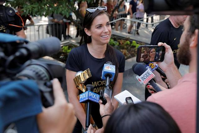 United States women's national soccer team player Alex Morgan speaks to media at the Wagner Hotel as she returned to the United States with her teammates after winning the Women's World Cup in New York