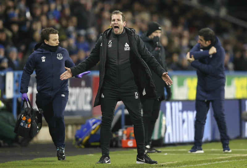 Huddersfield Town manager Jan Siewert reacts on the touchline during the game against Everton during their English Premier League soccer match at the John Smith's Stadium in Huddersfield, England, Tuesday Jan. 29, 2019. (Nigel French/PA via AP)