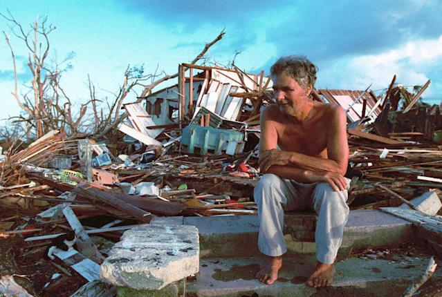 <p>In this Sept. 1, 1992 file photo, Janny Vancedarfield sits in front of the debris that was once his house in Florida City, Fla. Vancedarfield lived in this house with six other family members before it was destroyed by Hurricane Andrew in September 1992. Two decades later, Homestead and Florida City have doubled in size into a demographically different community, better prepared to deal with hurricanes. (AP Photo/Lynne Sladky, File) </p>