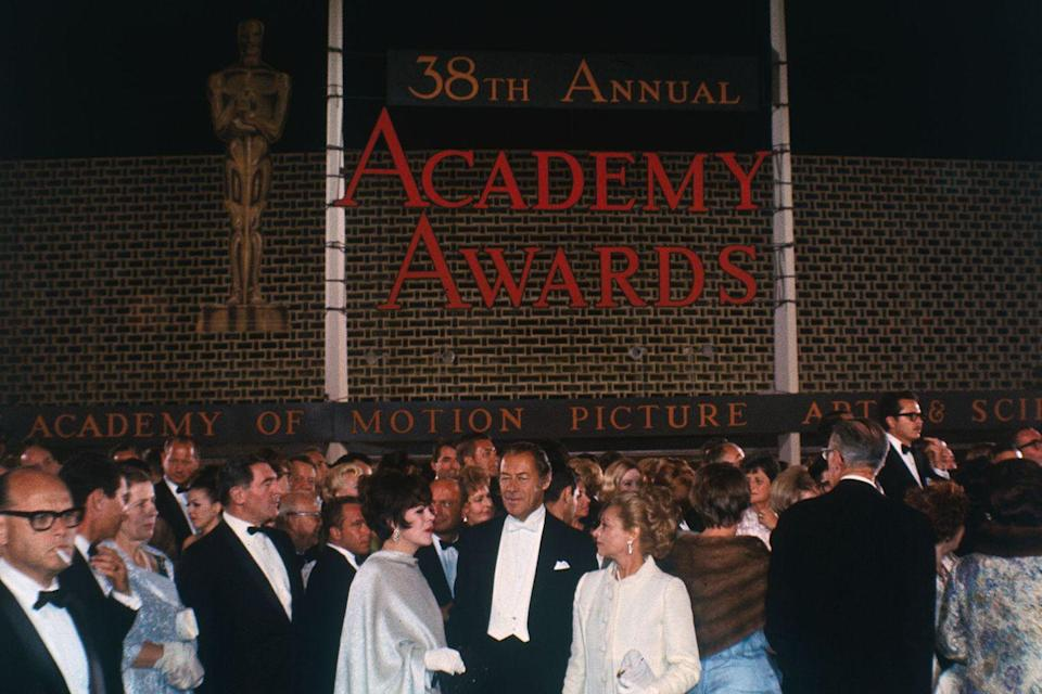 "<p>Presenter Rex Harrison and other stars gathered in front of the Santa Monica Civic Auditorium<span class=""redactor-invisible-space""> before the ceremony, which marked the first time the Oscars were broadcast in color. </span></p>"