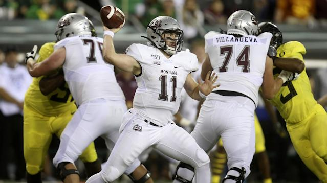 Montana's Dalton Sneed, center, throws down field against Oregon during the third quarter of an NCAA college football game Saturday, Sept. 14, 2019, in Eugene, Ore. (AP Photo/Chris Pietsch)