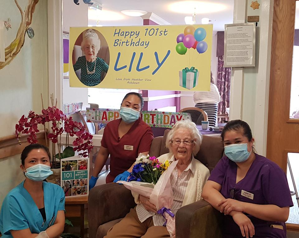 Lily with care home staff