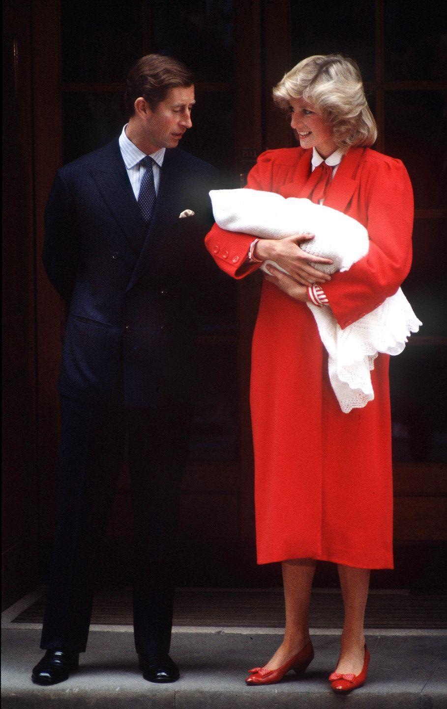 <p>In a red coat by Jan van Velden and matching pumps while leaving the hospital with newborn Prince Harry. </p>