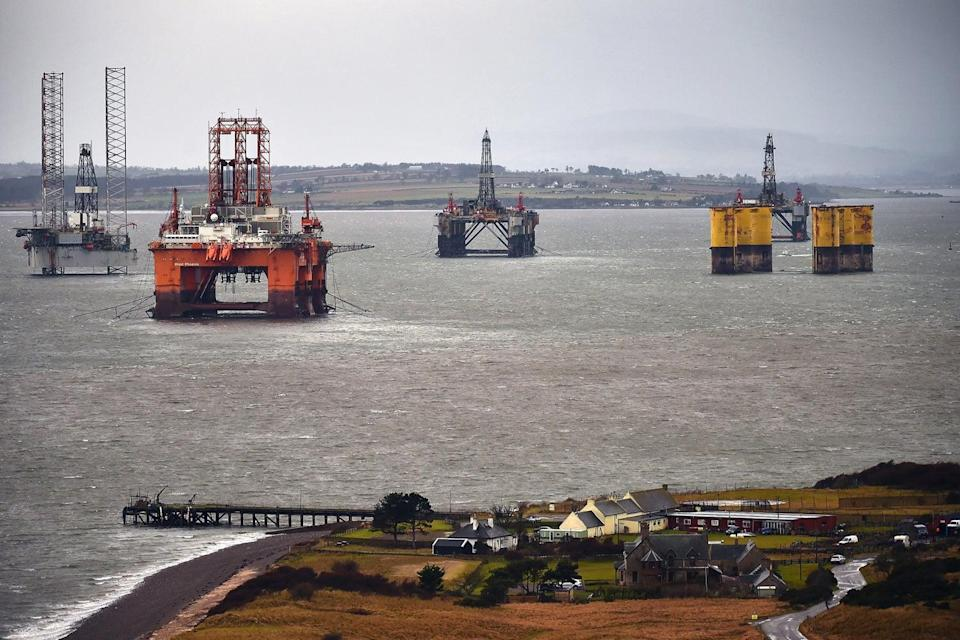 Oil rig platforms being stacked up in the Cromarty Firth, Scotland, as oil prices continue to decline