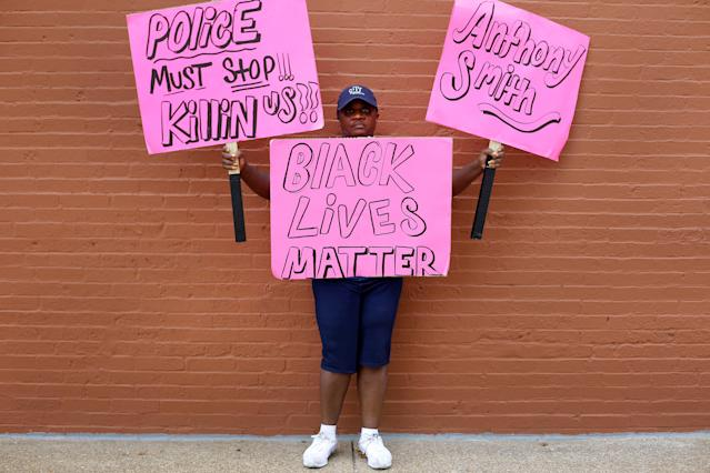 <p>A woman poses for a portrait as she protests the not guilty verdict in the murder trial of Jason Stockley, a former St. Louis police officer charged with the 2011 shooting of Anthony Lamar Smith, in St. Louis, Mo., Sept. 17, 2017. (Photo: Joshua Lott/Reuters) </p>