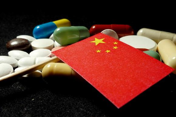 China flag on top of random pills and capsules.