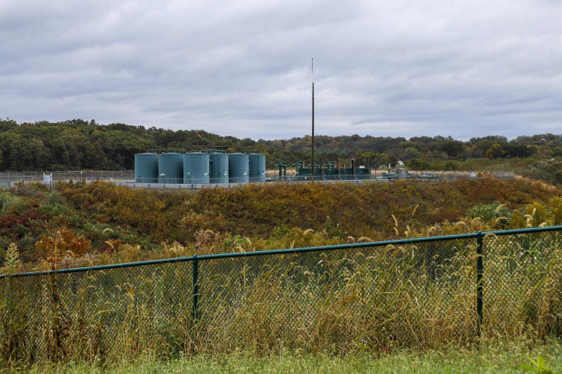 In this Oct. 17, 2019, photo, storage tanks are seen at a shale gas well pad in Zelienople, Pa. President Donald Trump has aligned with Pennsylvania's natural gas industry, but his support for the industry in the nation's No. 2 natural gas state may not yield the expected political boost in what is perhaps the nation's premier presidential battleground state. In parts of the state critical to his path to victory, opposition to fracking is growing and calls for getting tough on the industry are popular. (AP Photo/Keith Srakocic)