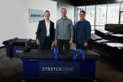 From left: Stretch Zone President and CEO Tony Zaccario, brand ambassador and franchise partner Drew Brees, and founder Jorden Gold