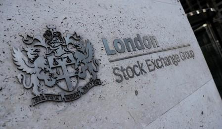 Trade worries hit FTSE 100, banks slip on BoE plan