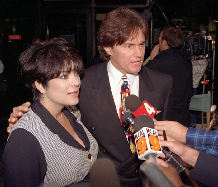 FILE - This Sept. 27, 1995 file photo shows Olympic gold medal champion Bruce Jenner and his wife Kris Jenner with the media at the Criminal Courts Building as they arrive for closing arguments in the O.J. Simpson double-murder trial in Los Angeles. The celebrity couple have confirmed they separated a year ago, after 22 years together. (AP Photo/Nick Ut, File)
