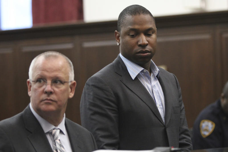 Detroit Tigers left fielder Delmon Young, right, accompanied by his attorney Daniel J.Ollen, is arraigned in Manhattan criminal court, Friday, April 27, 2012 in New York. Police say Young got into a fight with a group of men early Friday outside the team's midtown Manhattan hotel and yelled anti-Semitic epithets. (AP Photo/Mary Altaffer)