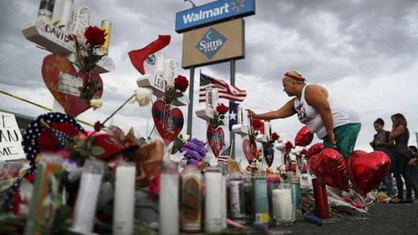 PHOTO: A woman touches a cross at a makeshift memorial for victims outside Walmart, near the scene of a mass shooting which left at least 22 people dead, on Aug. 6, 2019 in El Paso, Texas. (Mario Tama/Getty Images)