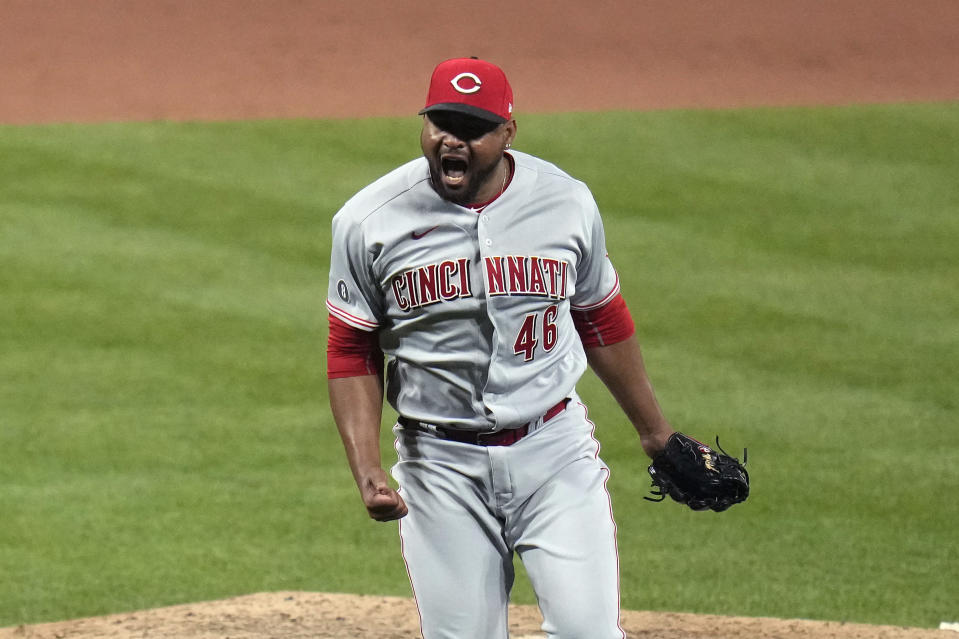 Cincinnati Reds pitcher Michael Feliz celebrates after striking out St. Louis Cardinals' Paul Goldschmidt to end a baseball game Friday, June 4, 2021, in St. Louis. The Reds won 6-4. (AP Photo/Jeff Roberson)