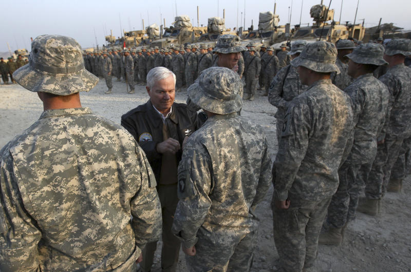 Defense Secretary Robert Gates pins Combat Infantry badges to soldiers at Forward Operating Base Connolly, in Kunar Province, Afghanistan, Tuesday, Dec. 7, 2010. Gates arrived today in Afghanistan for an unannounced visit during a tour of the region this week.  (AP Photo/Win McNamee, Pool)