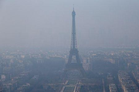 A general view shows the Eiffel Tower and the Paris skyline through a small-particle haze