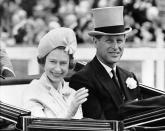 FILE - In this June 19, 1962 file photo, Britain's Queen Elizabeth II and Prince Philip travel by open carriage around the track prior to the race program, at Ascot, England. Prince Philip was the longest serving royal consort in British history. In Britain, the husband or wife of the monarch is known as consort, a position that carries immense prestige but has no constitutional role. (AP Photo/File)