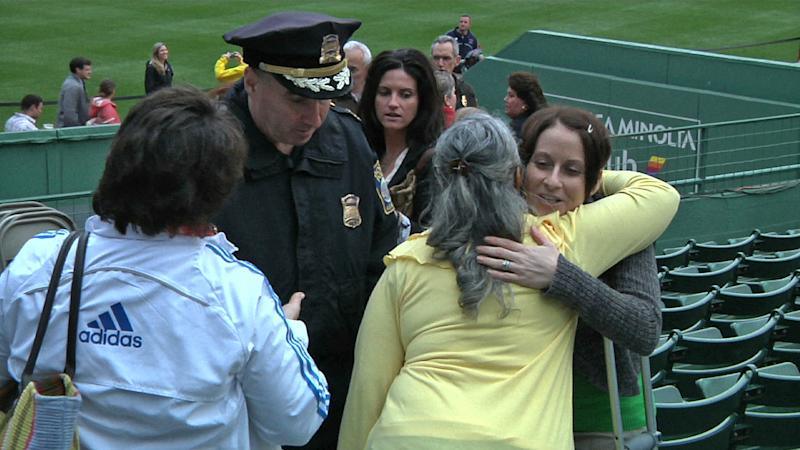 In this image from video Brigham and Women's Hospital nurse Laura Wilson-Mills, hugs bombing victim Lee Ann Yanni during the Boston Bites Back event Wednesday May 15, 2013. (AP Photo/Ngowi Rodrique)