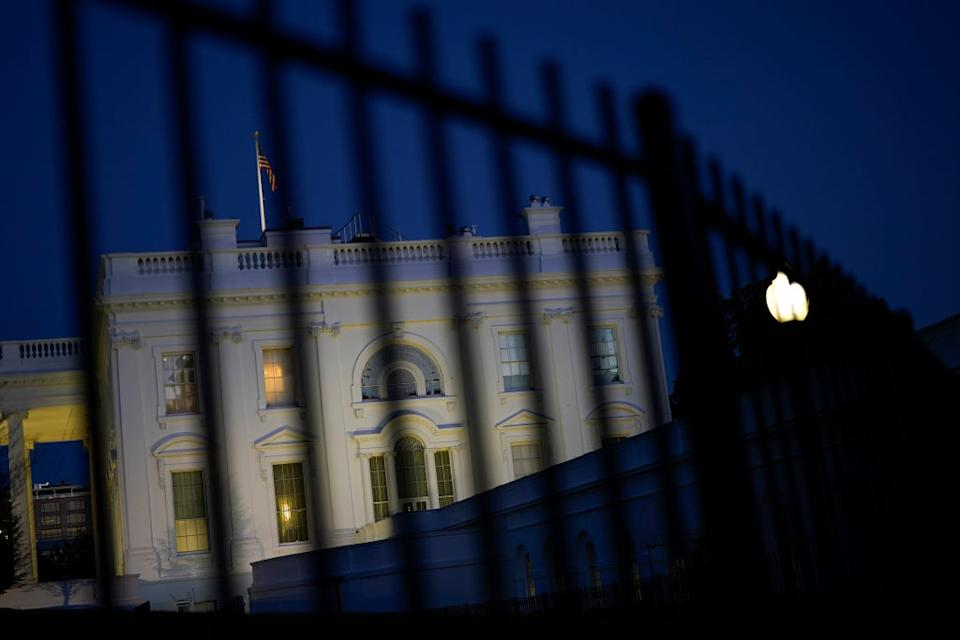 The White House under darkness.