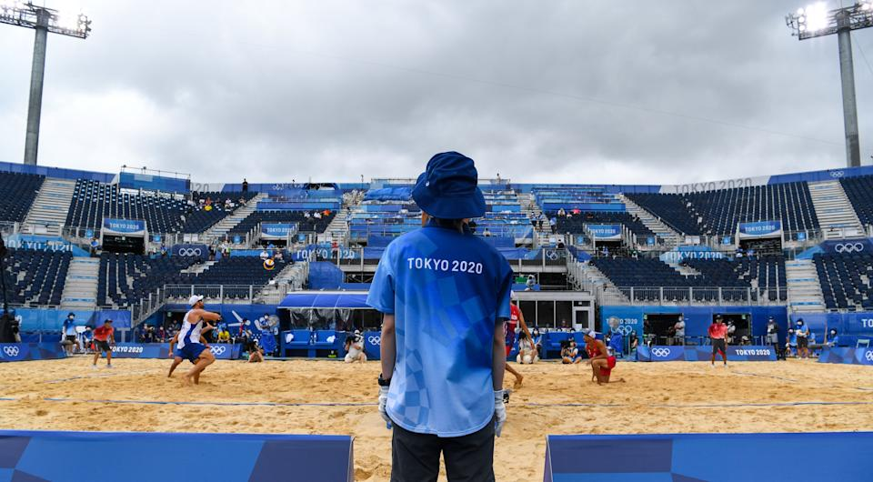 Empty stands in the men's preliminary beach volleyball match between Brazil and the United States at the 2020 Tokyo Olympics.