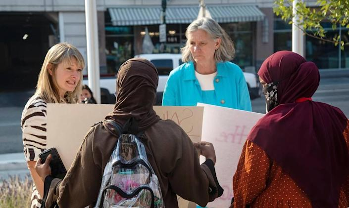 Boise city council members Holli Woodings and Elaine Clegg briefly meet with members of Boise's East African community and other Black Lives Matter supporters in front of City Hall on Tuesday as they protest the police shooting of Mohamud Hassan Mkoma.