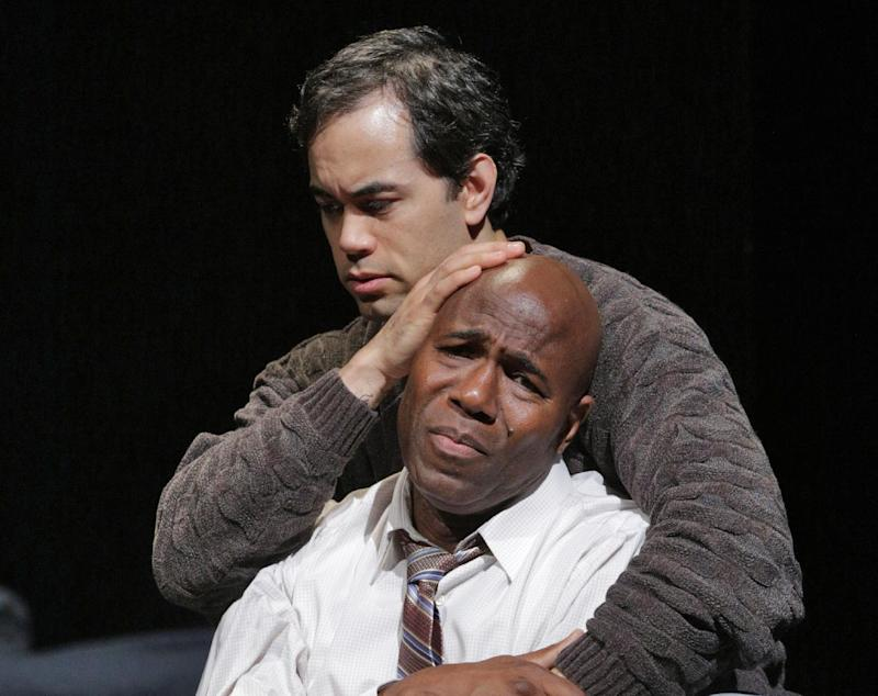 """This undated image released by the Opera Theatre of Saint Louis shows Arthur Woodley as Emile Griffith, foreground, and Brian Arreola as Luis Rodrigo Griffith in Opera Theatre of Saint Louis' 2013 world premiere production of """"Champion,"""" by Jazz composer Terence Blanchard. Blanchard's """"Champion"""" _ with a libretto by Pulitzer Prize-winning playwright Michael Cristofer _ is based on the life of former world welterweight and middleweight champion Emile Griffith. Its world premiere comes at the Opera Theatre of St. Louis on Saturday, June 15. (AP Photo/Opera Theatre of Saint Louis, Ken Howard)"""