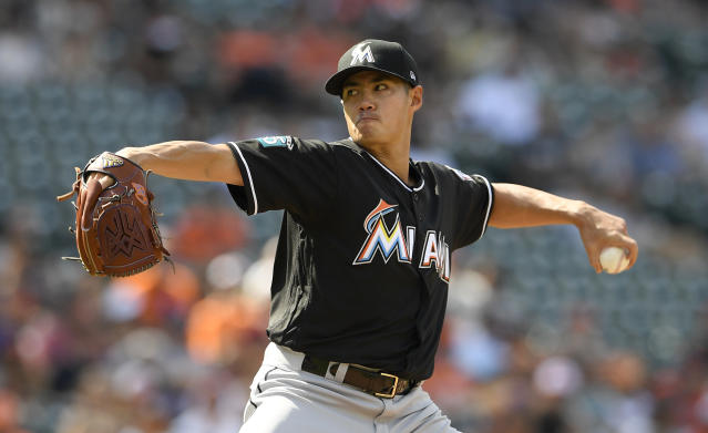 Miami Marlins starting pitcher Wei-Yin Chen, of Taiwan, delivers a pitch during the first inning of a baseball game against the Baltimore Orioles, Saturday, June 16, 2018, in Baltimore. (AP Photo/Nick Wass)