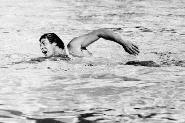 Actor Johnny Weissmuller is seen swimming in this 1936 photo. (AP Photo)