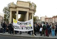 """People hold a banner that says, """"For Remi Fraisse 26.10.14 Never forgive, Never forget"""" on October 26, 2016 in Toulouse, southwestern France, during a rally to pay a tribute to the environmental activist who died during clashes with security forces"""