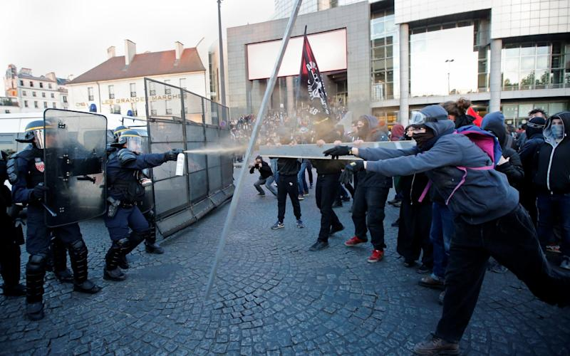 French riot police clash with demonstrators - Credit:  JEAN-PAUL PELISSIER/REUTERS