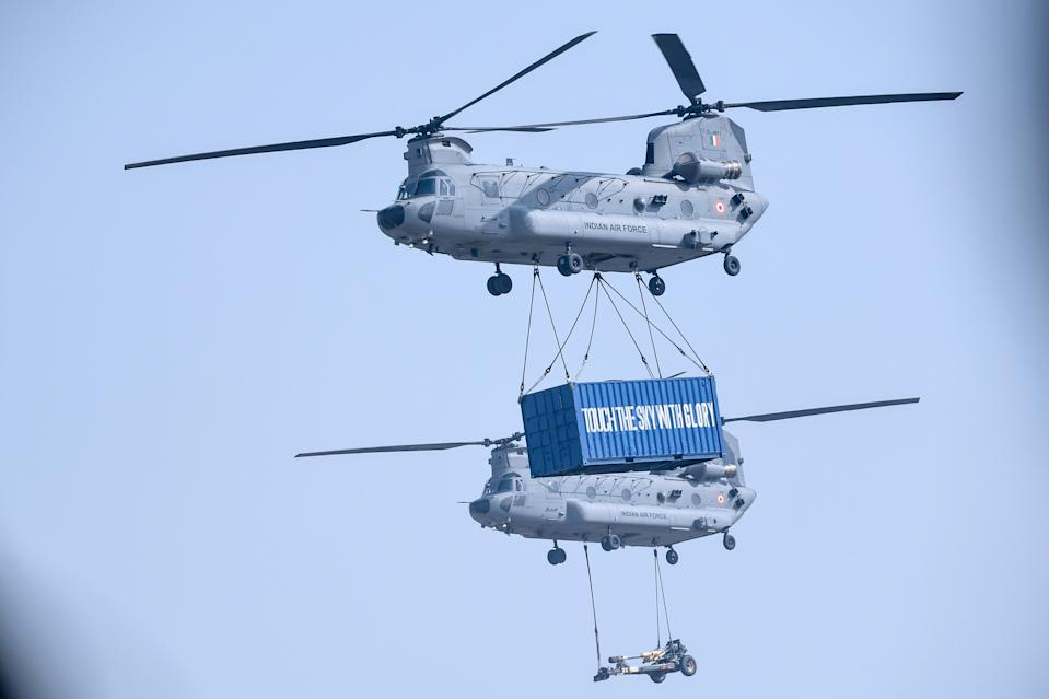 Indian Air Force (IAF) Chinook helicopters transport a freight during the 88th Air Force Day parade at Hindon Air Force station in Ghaziabad on October 8, 2020. (Photo by Money SHARMA / AFP) (Photo by MONEY SHARMA/AFP via Getty Images)