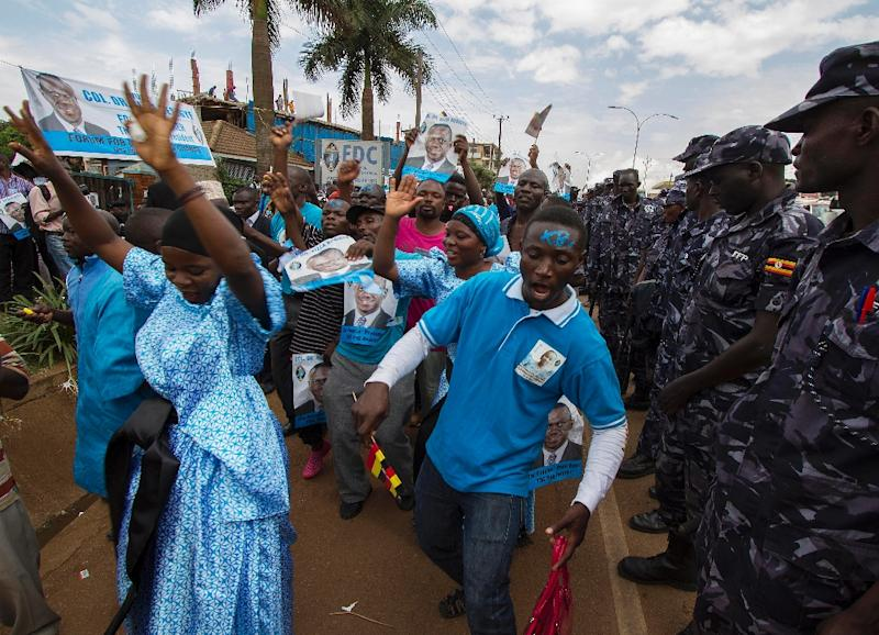 Supporters of Kizza Besigye celebrate in Kampala, on July 1, 2015, after Besigye was nominated in absentia for the presidential elections (AFP Photo/Isaac Kasamani)