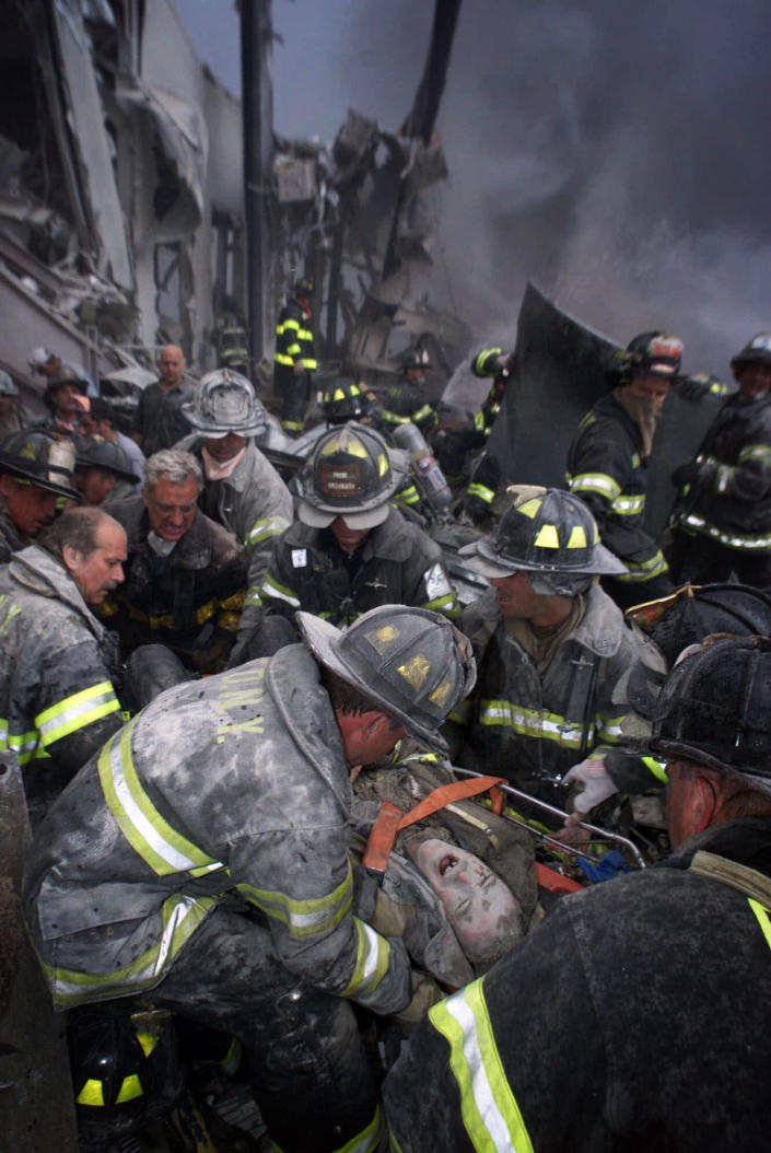 <p>A fireman screams in pain as he is rescued shortly after both towers of New York's World Trade Center collapsed following a terrorist attack, Tuesday, Sept. 11, 2001. (Robert Mecea/Newsday via AP)</p>