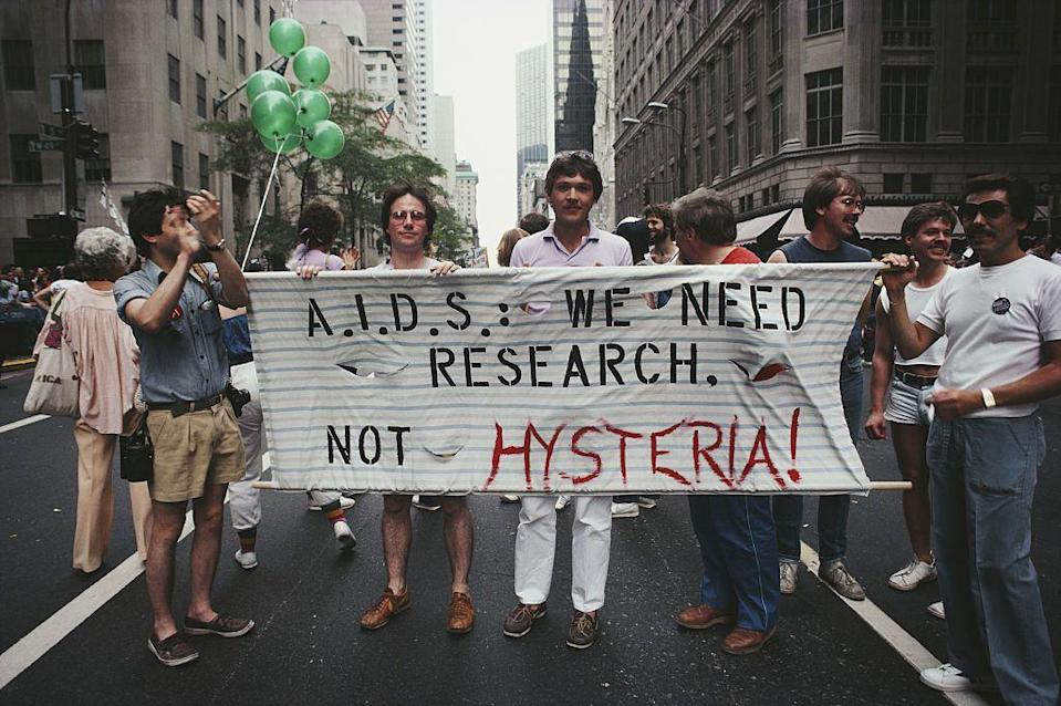 """<p>To many, this moment should have come much earlier, but in September 1982 the CDC finally recognized the AIDS virus and made <a href=""""https://www.cdc.gov/mmwr/preview/mmwrhtml/00001163.htm"""" rel=""""nofollow noopener"""" target=""""_blank"""" data-ylk=""""slk:reports"""" class=""""link rapid-noclick-resp"""">reports</a> confirming cases. This was monumental since many people doubted the existence of the virus or simply labeling it as a """"gay sickness.""""</p>"""