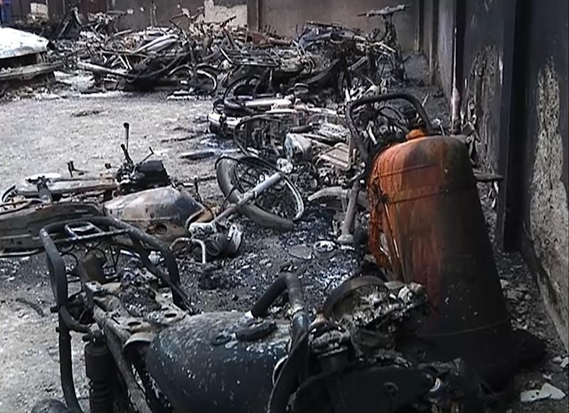 Burnt motorcycles after the blast in Nnewi (AFP Photo/)