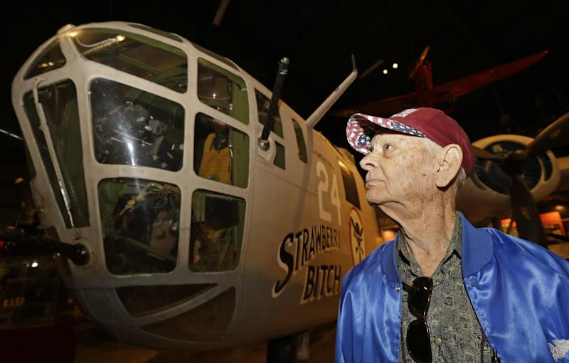 Dale Hulsey, from Forth Worth Texas, views a B24 bomber like the one he flew in the Ploesti Raid during World War II while touring the United States Air Force Museum, Wednesday, July 31, 2013, in Dayton, Ohio. The planes flew a dangerous low altitude raid on Aug. 1, 1943, targeting heavily defended oil fields in occupied Romania. Survivors of the raid are having a 70th reunion Thursday in Dayton. (AP Photo/Al Behrman)