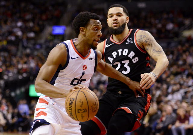Washington Wizards guard Ish Smith (14) moves past Toronto Raptors guard Fred VanVleet (23) during the second half of an NBA basketball game Friday, Dec. 20, 2019, in Toronto. (Frank Gunn/The Canadian Press via AP)