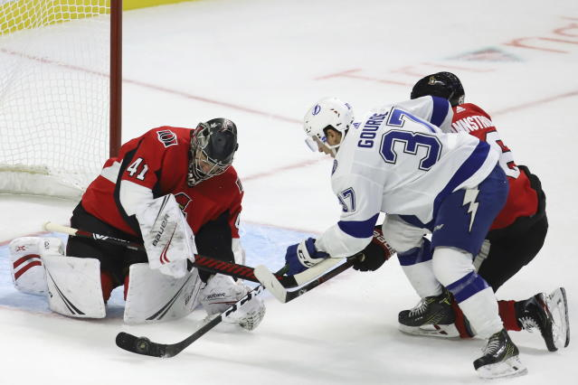 Tampa Bay Lightning centre Yanni Gourde (37) shoots on Ottawa Senators goaltender Craig Anderson (41) as defenceman Erik Brannstrom (26) attempts to defend during second period of NHL hockey action in Ottawa, Saturday, Oct. 12, 2019. (Fred Chartrand/The Canadian Press via AP)