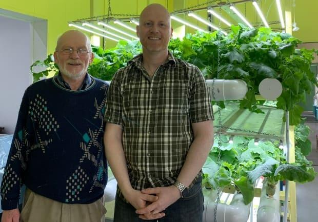 Hayward Budden, left, and son Dwight Budden built an indoor hydroponic farm in Stag Harbour, Fogo Island.  (Melissa Tobin/CBC - image credit)