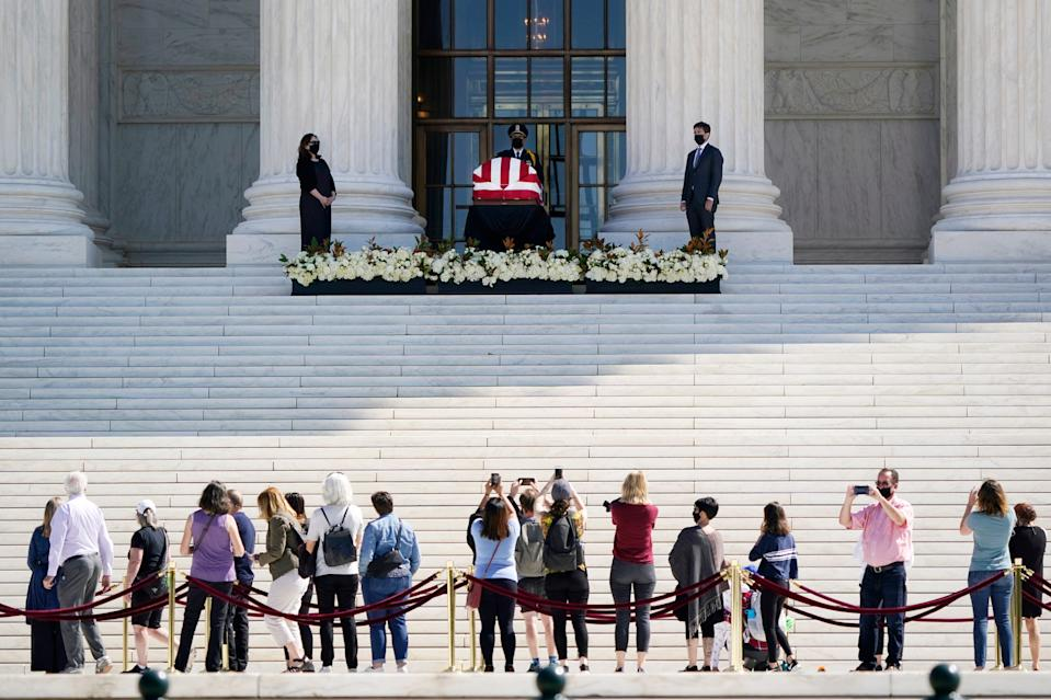 People pay respects as Justice Ruth Bader Ginsburg lies in repose under the portico at the top of the front steps of the U.S. Supreme Court Sept. 23.