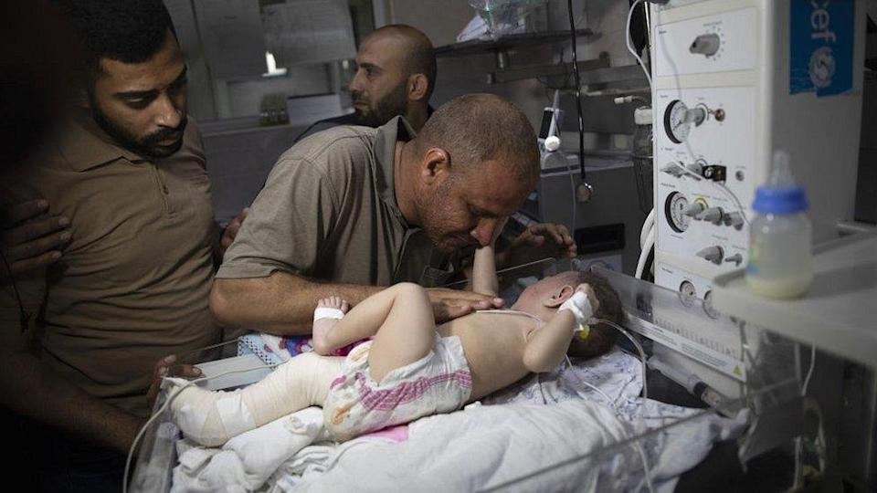 Five-month-old Palestinian baby Omar Hadidi who lost his mother and siblings in the Israeli airstrike, whose homes in Shati Refugee Camp were completely destroyed, receives medical treatment at Shifa Hospital in Gaza City, Gaza
