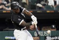 Chicago White Sox's Tim Anderson hits a double during the sixth inning of the team's baseball game against the Houston Astros in Chicago, Saturday, July 17, 2021. (AP Photo/Nam Y. Huh)