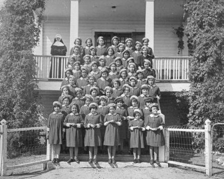 Female students pose for a class portrait at St. Anthony's Indian Residential School in Onion Lake, Saskatchewan in a 1950 archive photo. REUTERS/Canada. Dept. of Indian Affairs and Northern Development/Library and Archives Canada/PA-202480/handout