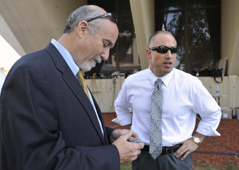 "FILE - In this Sept. 6, 2012 file photo, Joel Brodsky, left, and Steven Greenberg, attorneys for former Bolingbrook police officer Drew Peterson, confer outside the Will County Courthouse in Joliet, Ill., during the jury deliberations in Peterson's murder trial. Brodksy, the one-time lead attorney for Peterson, has filed a lawsuit Wednesday, Feb. 6, 2013,  claiming that Greenberg, who is still on Peterson's legal team defamed him. The lawsuit filed in Cook County Circuit Court says Greenberg circulated a letter accusing Brodsky of ""single-handedly"" losing Peterson's trial. (AP Photo/Paul Beaty, File)"