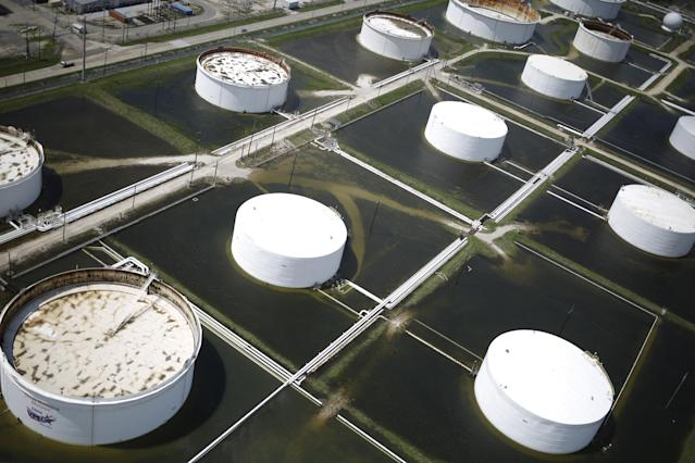 <p>Rainwater from Hurricane Harvey surrounds oil refinery storage tanks in this aerial photograph taken above Texas City, Texas on Wednesday, Aug. 30, 2017. (Photo: Luke Sharrett/Bloomberg via Getty Images) </p>